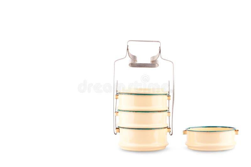 在白色背景厨具对象的涂上的钢食物载体tiffin载体隔绝了 库存照片