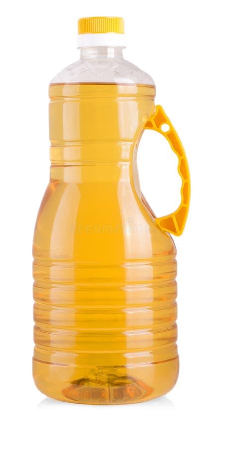 在白色背景向日葵油隔绝的大瓶 免版税库存照片