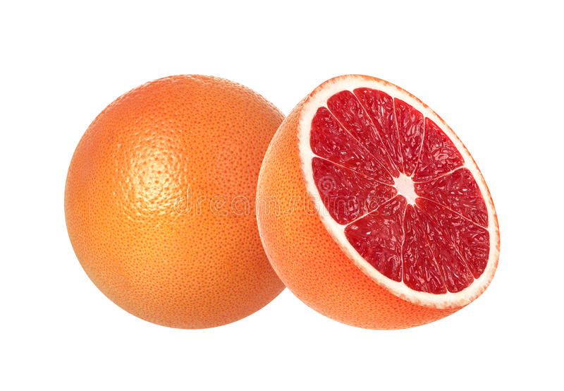 在白色背景和半粉红色葡萄柚隔绝的整体 库存图片