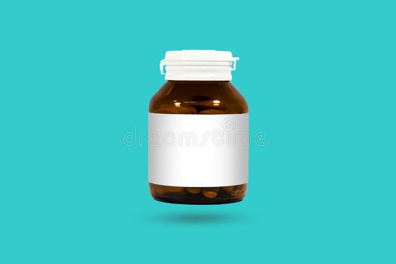 在白色背景和瓶隔绝的维生素C片剂 Studi 免版税库存照片