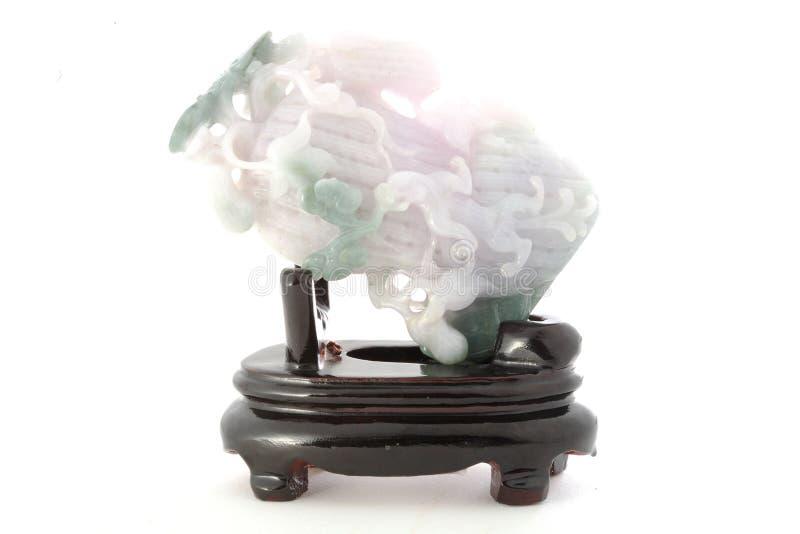 在白色背景在中国式的玉雕塑隔绝的 库存照片