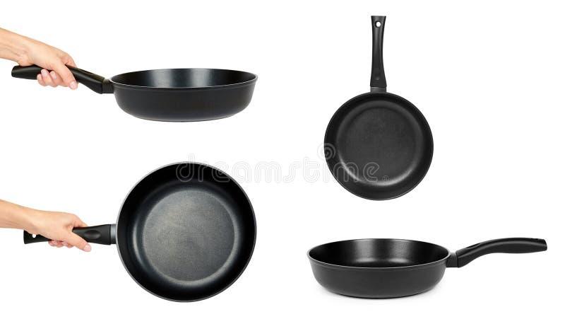 在白色背景在手中隔绝的套不同的黑炸锅 免版税库存图片