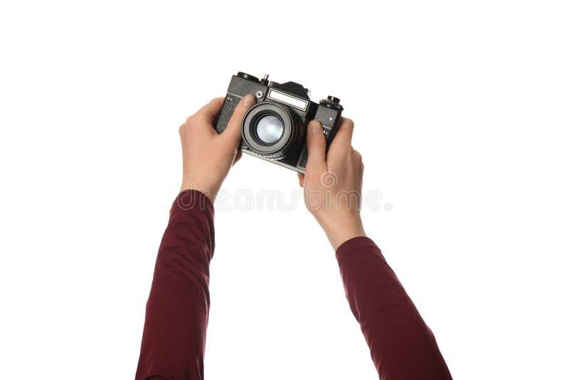 在白色背景在手中隔绝的葡萄酒照相机 摄影和记忆 库存图片