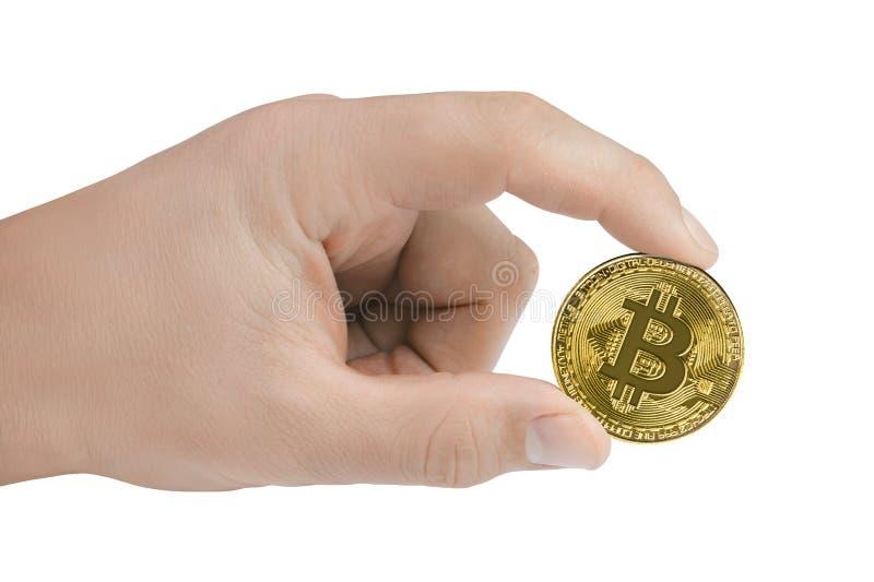 在白色背景在手中隔绝的金黄Bitcoin 免版税图库摄影
