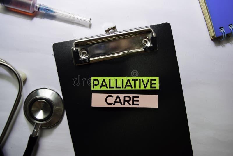 在白色背景在顶视图的缓和关心文本隔绝的 医疗保健/医疗概念 库存照片