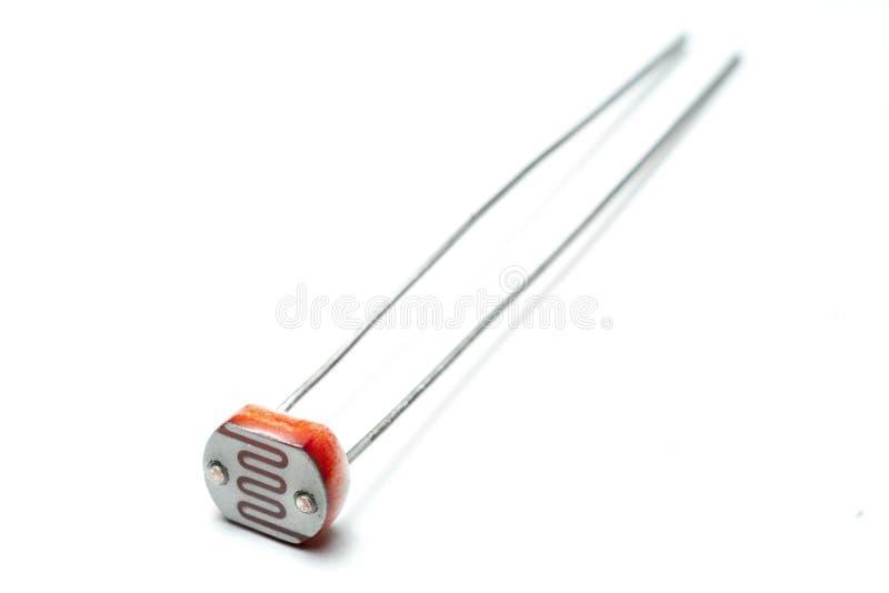 在白色背景宏指令射击的光敏电阻 免版税图库摄影