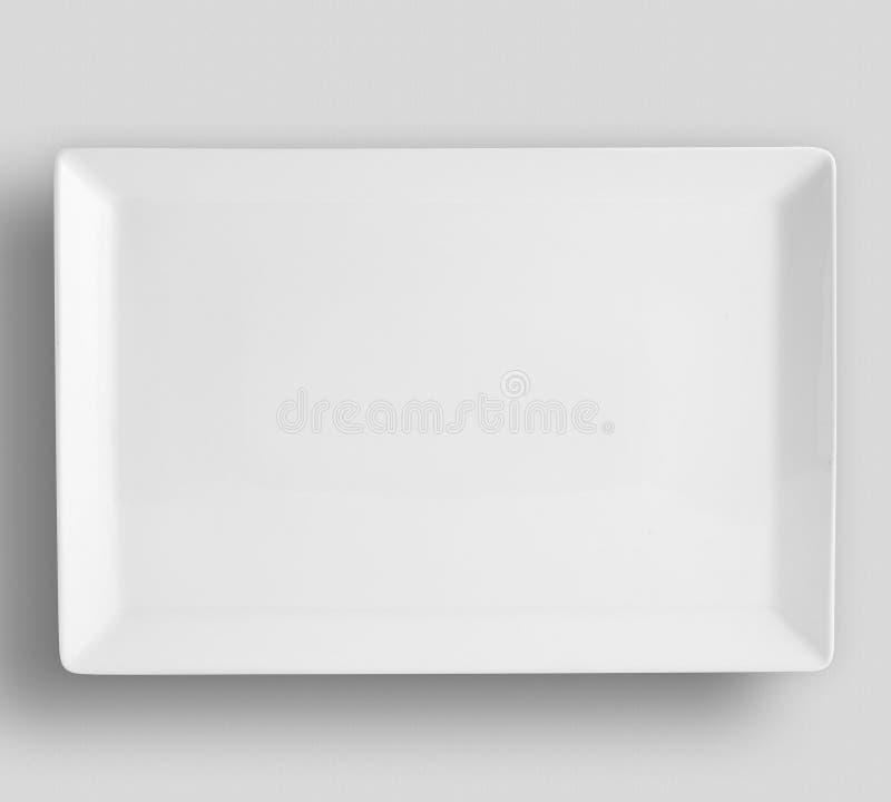 在白色背景影像,在被隔绝的背景影像的空的白色板材圈子的板材 库存照片