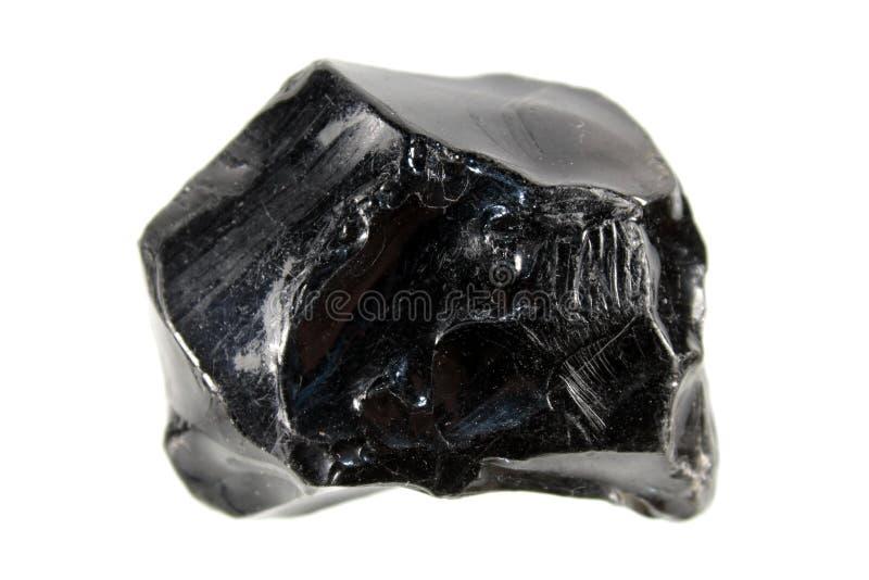 在白色背景或松脂石隔绝的黑曜石 免版税库存照片