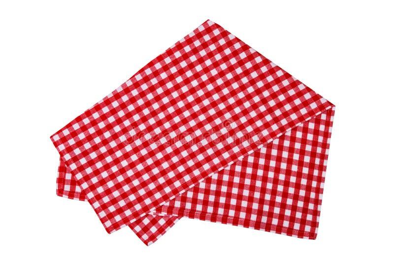 在白色背景或桌布的隔绝的特写镜头一张红色和白色方格的餐巾 辅助部件背景查出的厨房白色 库存照片