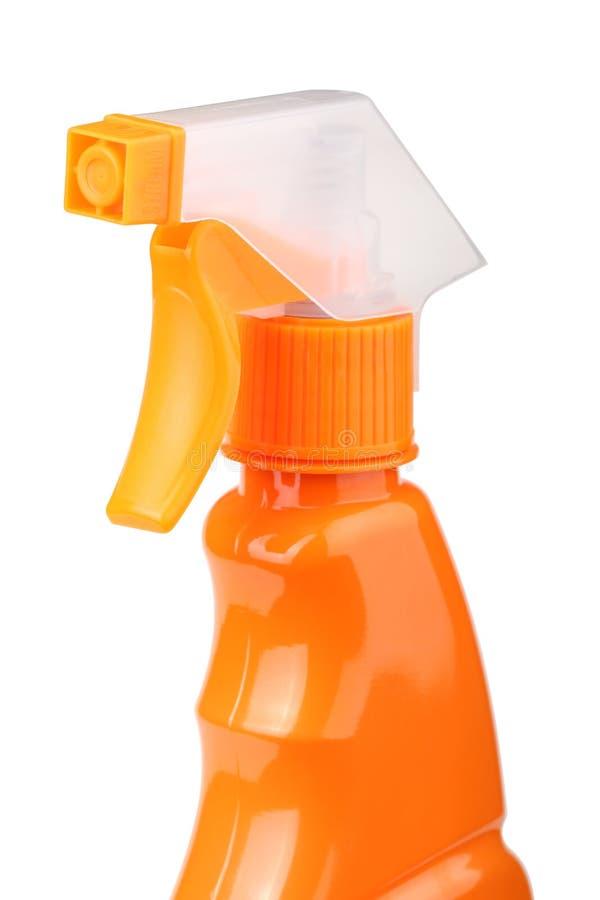 在白色背景有触发器的橙色塑料喷雾器隔绝的 图库摄影