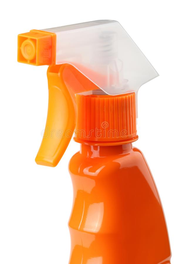 在白色背景有触发器的橙色塑料喷雾器隔绝的 免版税库存图片