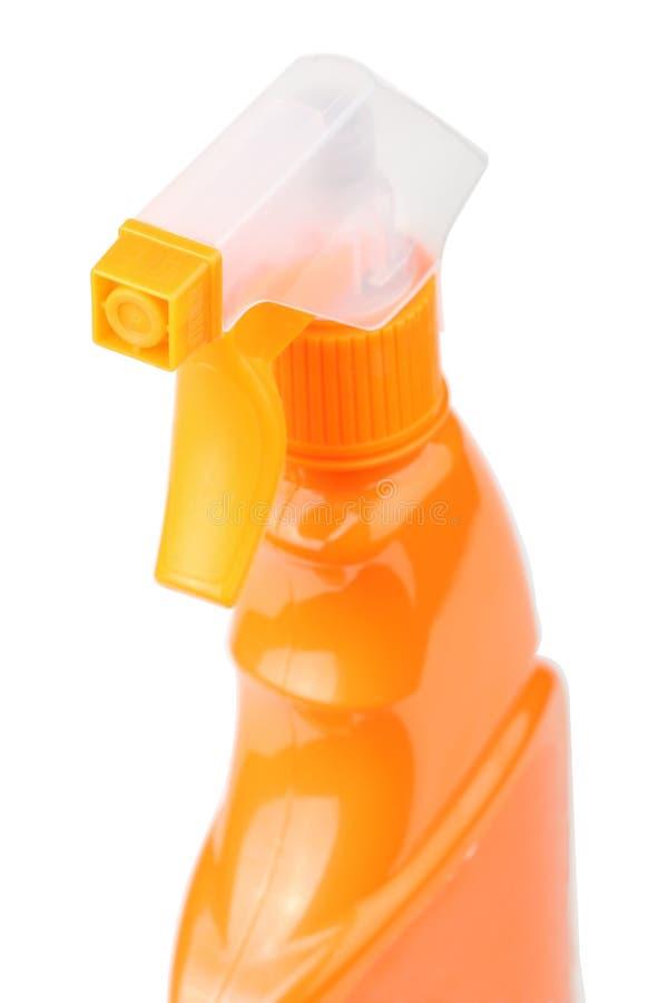 在白色背景有触发器的橙色塑料喷雾器隔绝的 库存图片