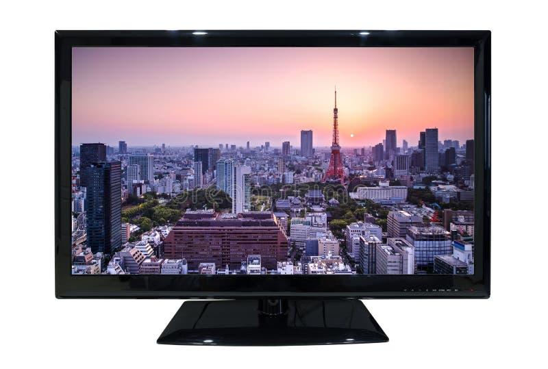 在白色背景有都市风景视图隔绝的大被带领的电视 免版税图库摄影