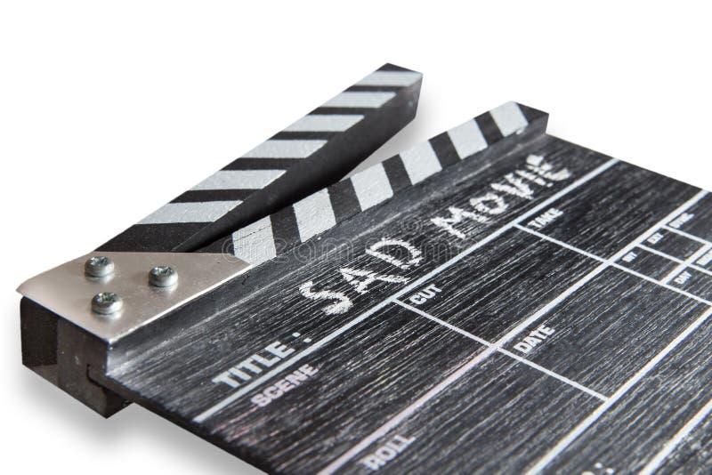 在白色背景标题哀伤的电影的拍板 库存图片