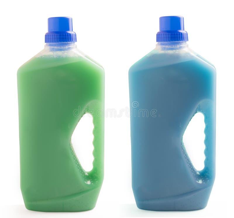 在白色背景清洁液体隔绝的两个塑料瓶 库存图片