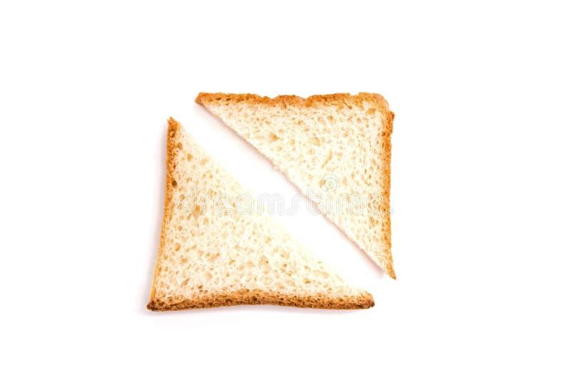 在白色背景的一被切的多士面包 免版税库存图片