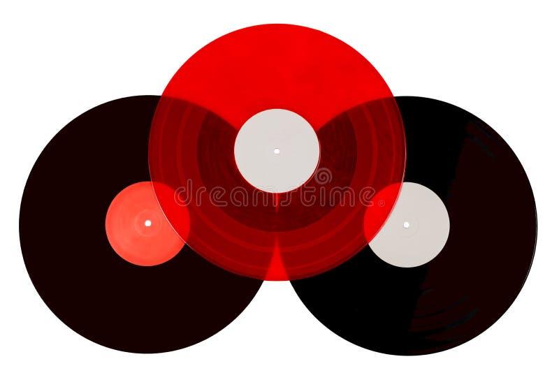 在白色背景的三个唱片 免版税库存照片