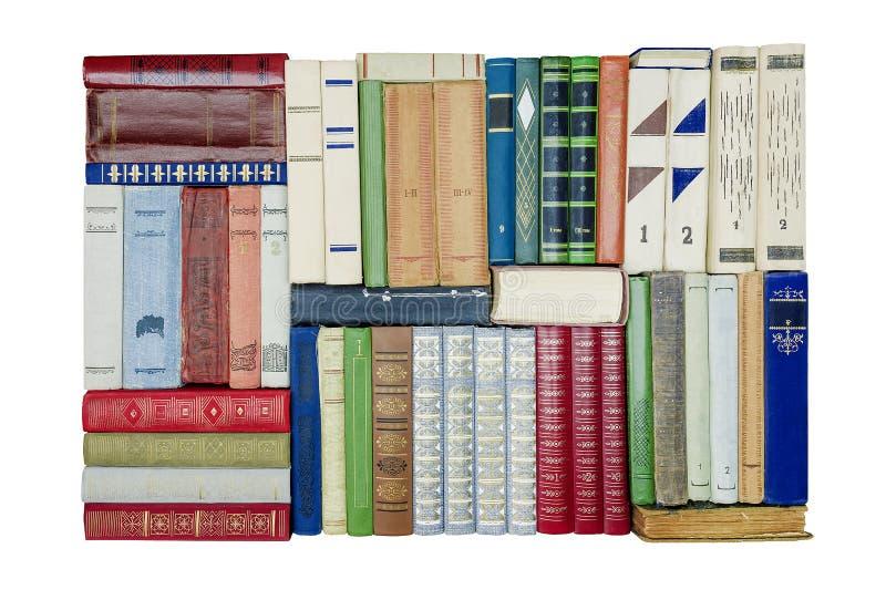 在白色背景的不同的书 免版税库存照片