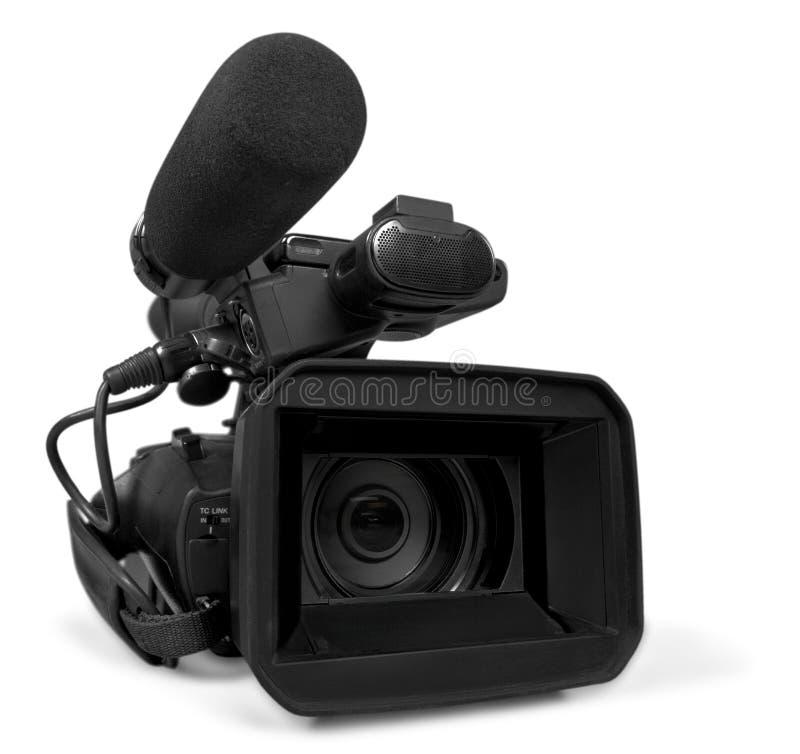 在白色背景的专业摄象机 免版税库存照片