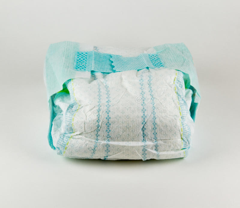 在白色背景的充分的婴孩尿布 库存照片