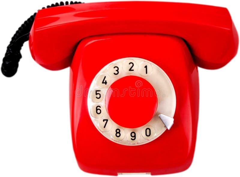 在白色背景的减速火箭的红色电话 免版税库存照片