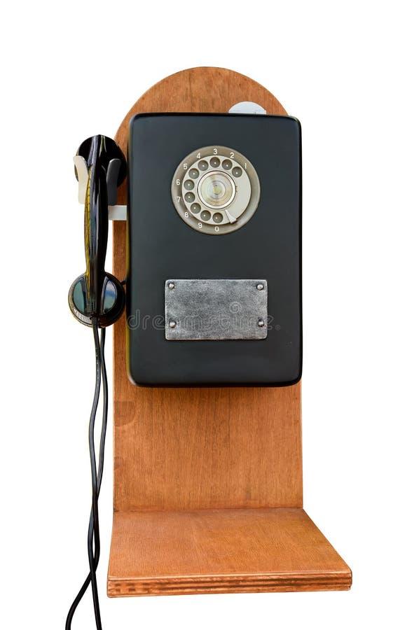 在白色背景的减速火箭的转台式老电话 免版税库存图片