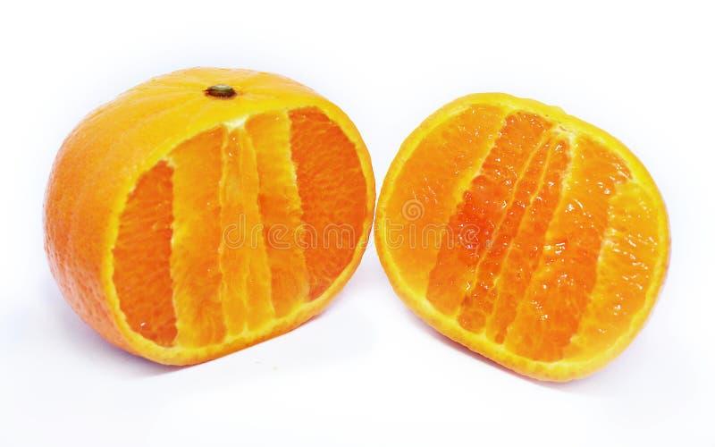 在白色背景的切的桔子 图库摄影