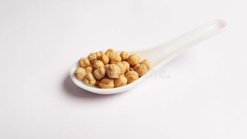 在白色背景的别致的豌豆 免版税图库摄影
