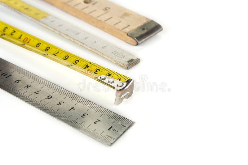 在白色背景的各种各样的米与铅笔 免版税库存图片
