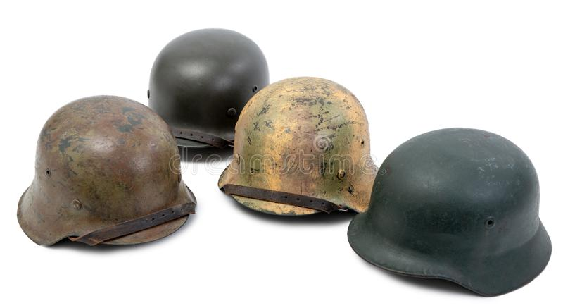在白色背景的四件德国第二次世界大战Stahlhelm军事盔甲 免版税库存照片