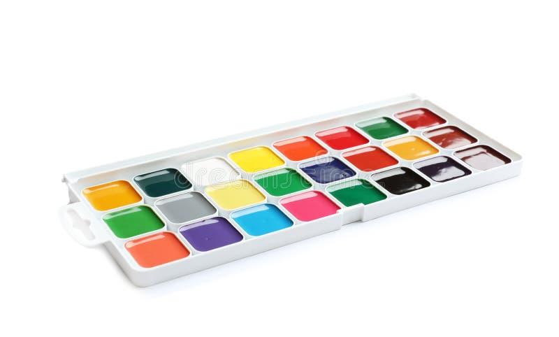 在白色背景的塑料水彩调色板 免版税库存图片