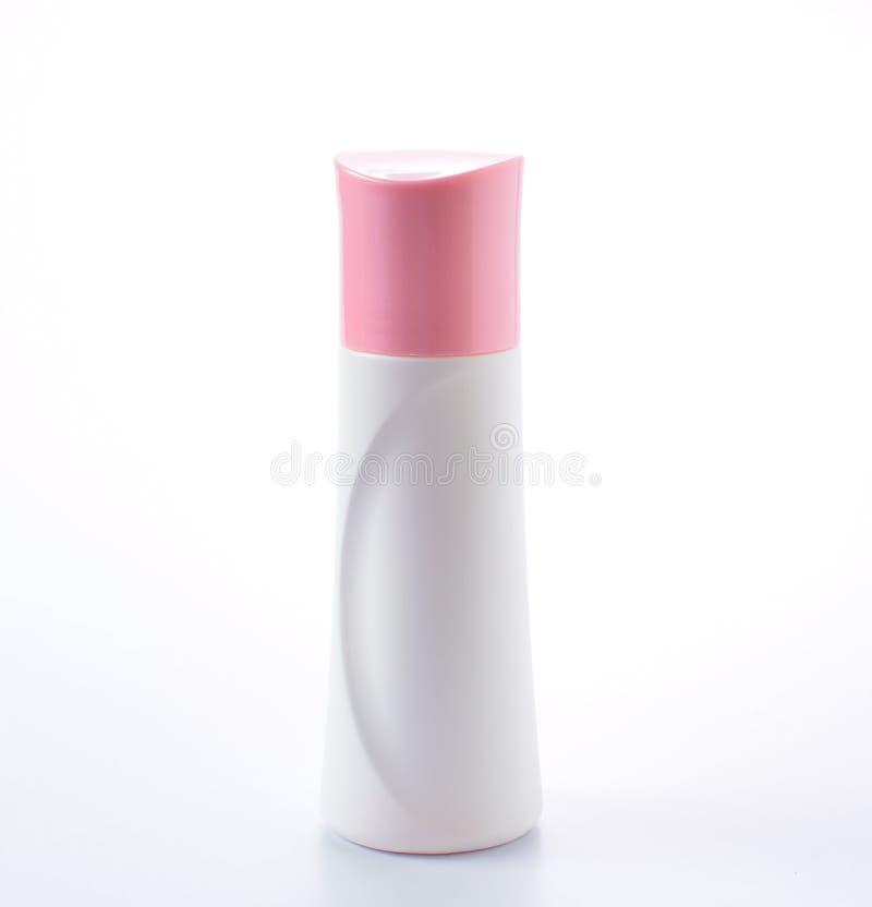 在白色背景的塑料瓶桃红色盖帽 库存图片