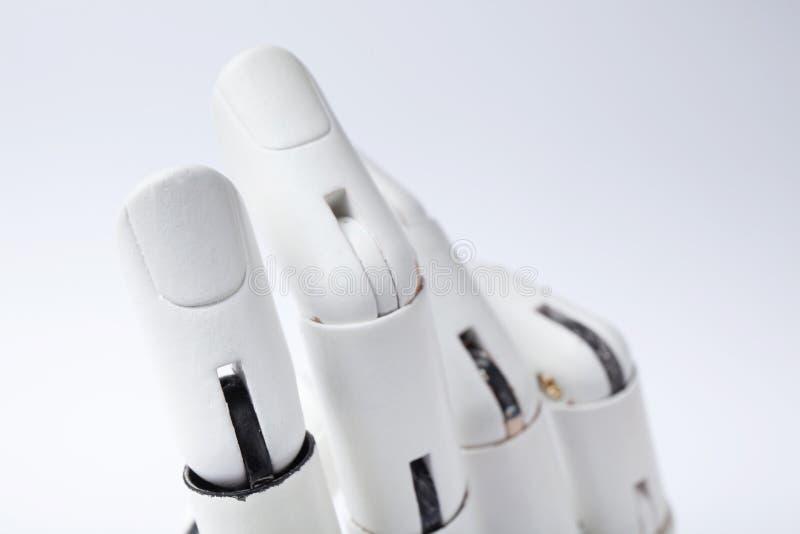在白色背景的塑料综合性手 免版税库存照片