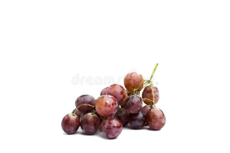 在白色背景的大紫色葡萄 免版税库存照片