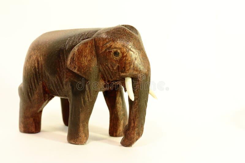 在白色背景的大象小雕象 库存照片