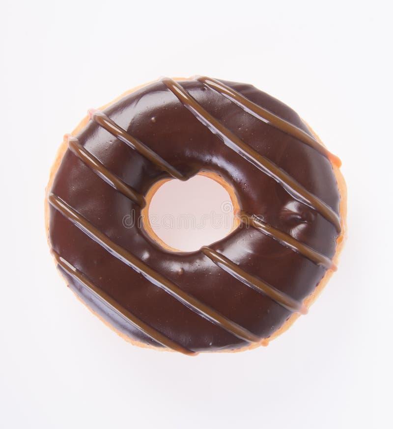 在白色背景的巧克力油炸圈饼 免版税库存图片