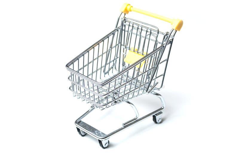 在白色背景的微型超级市场台车 库存图片