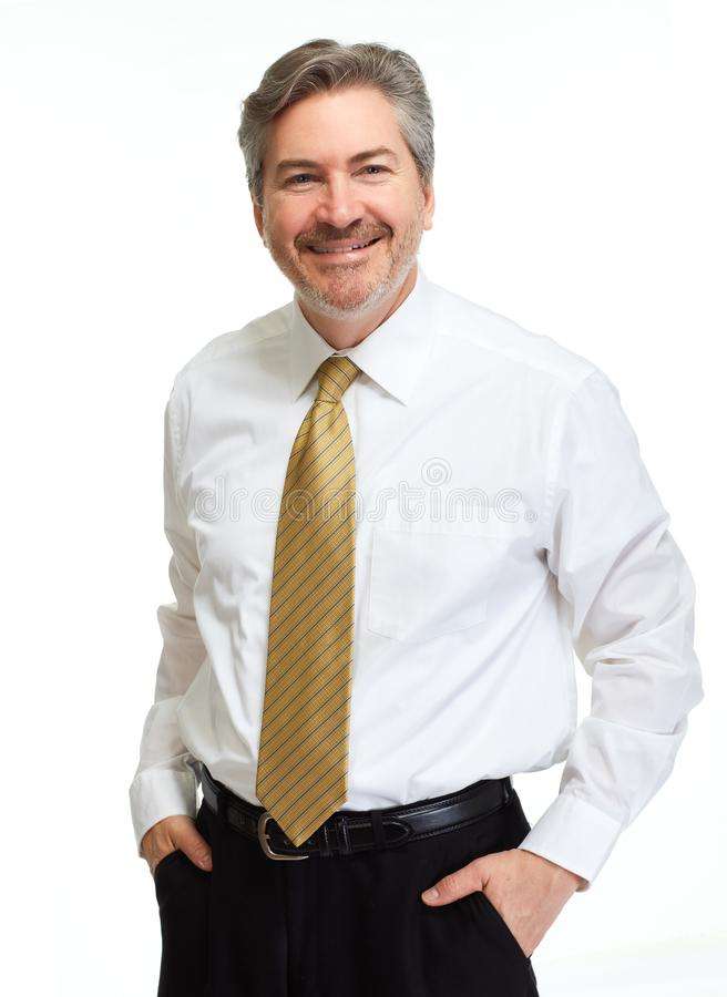 在白色背景的微笑的商人 免版税库存图片