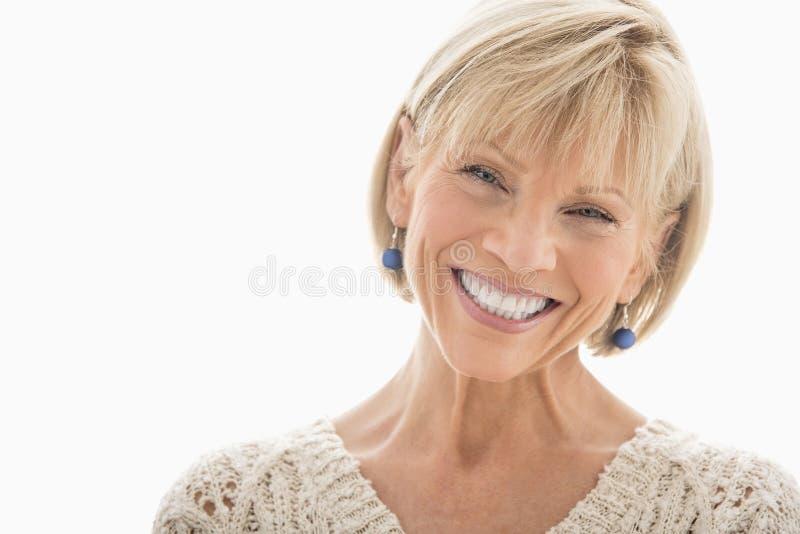 在白色背景的愉快的成熟妇女 免版税库存照片