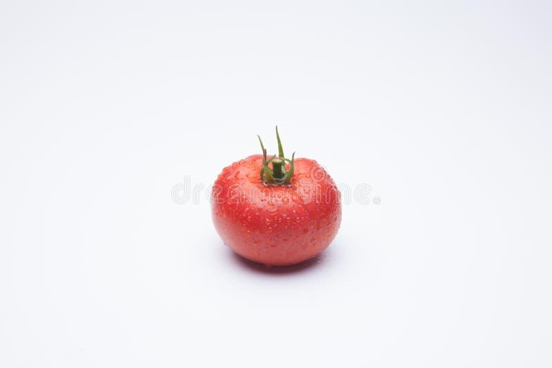 在白色背景的成熟蕃茄 免版税库存图片