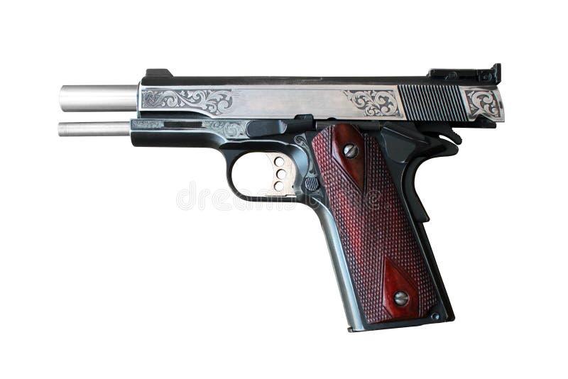 在白色背景的手枪 免版税库存照片