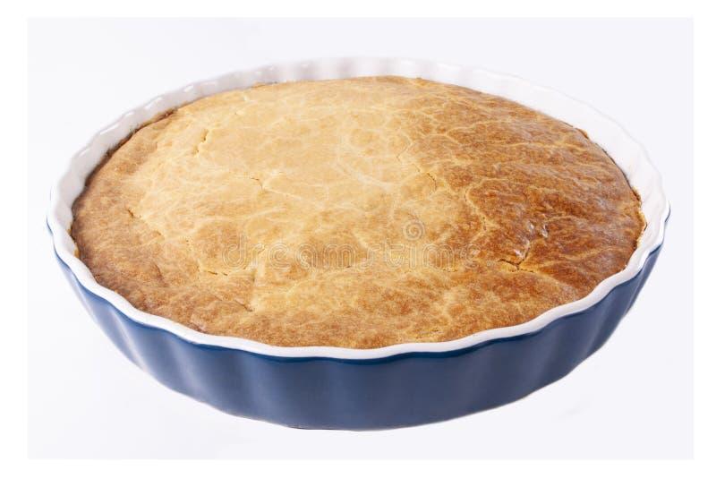 在白色背景的新鲜的自创牧羊人的饼 免版税库存照片