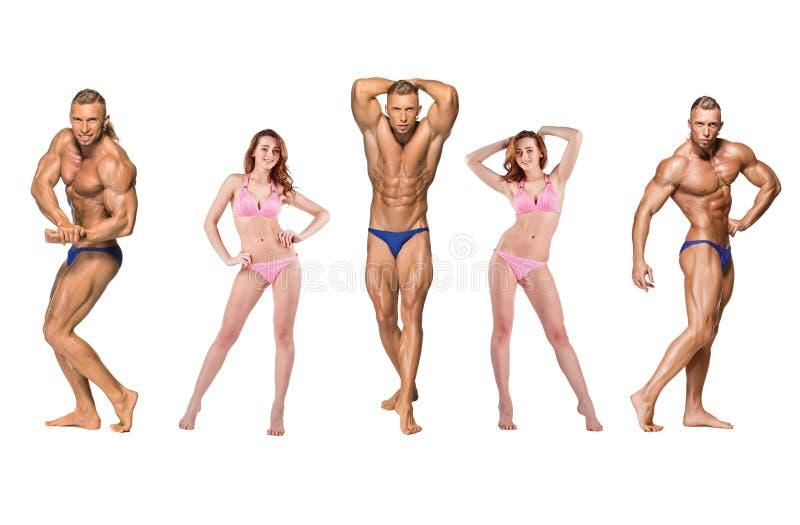 在白色背景的有吸引力的男性身体建造者 图库摄影