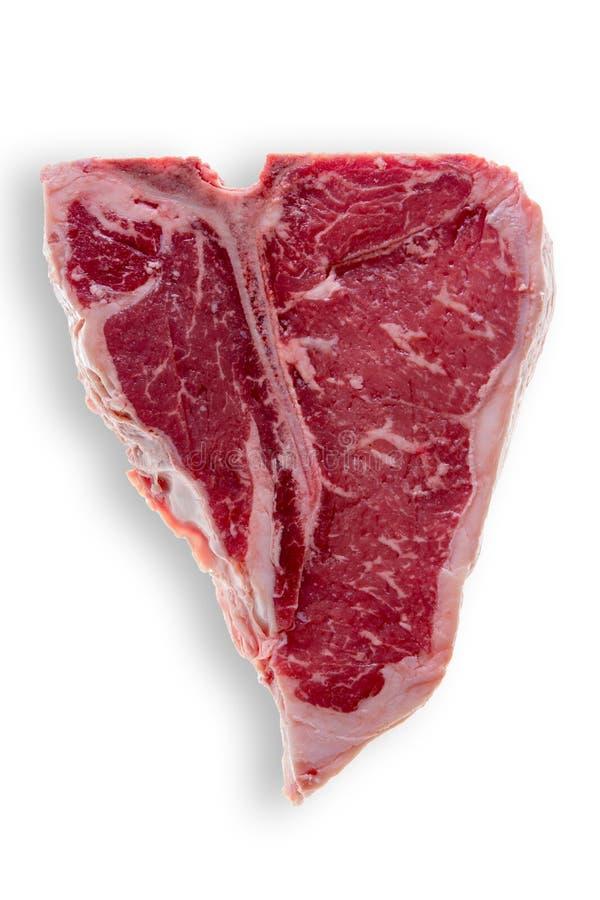 在白色背景的未煮过的丁骨牛排 免版税库存照片