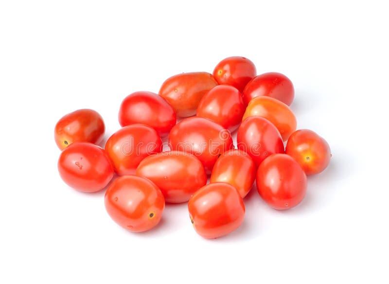 在白色背景的李子西红柿 免版税库存图片