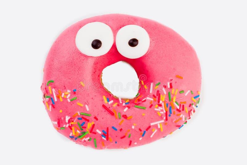 在白色背景的桃红色滑稽的惊奇的多福饼 库存照片