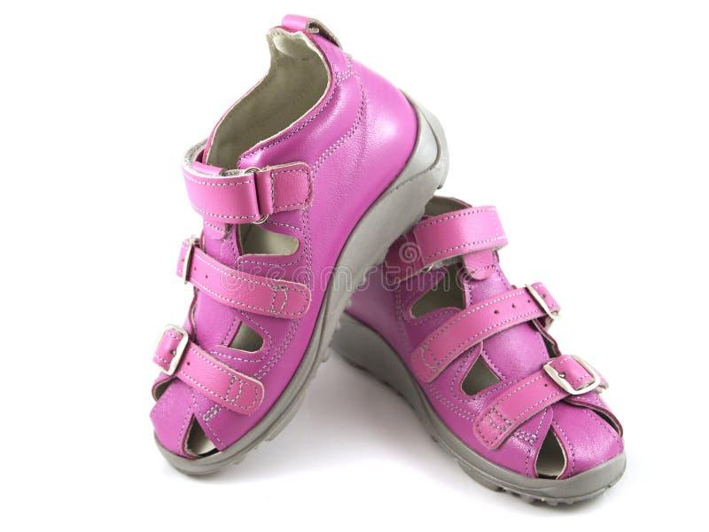 在白色背景的桃红色鞋子 免版税库存图片