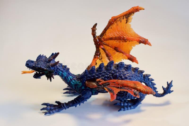 在白色背景的玩具恐龙 库存图片