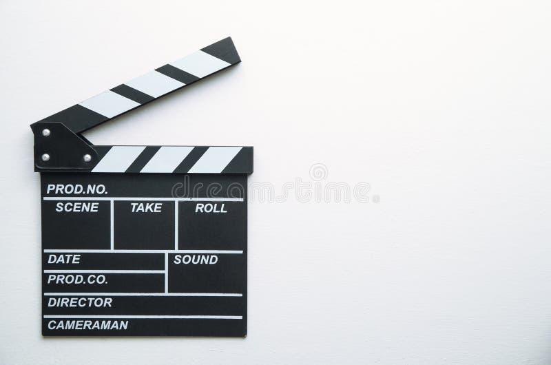 在白色背景的电影拍板 免版税库存照片