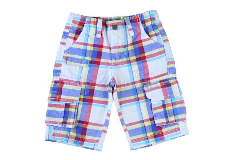 在白色背景的男孩方格的短裤 库存图片